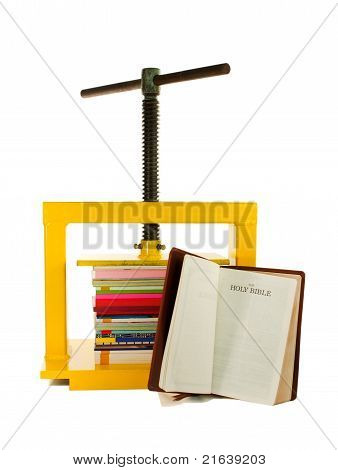 The Bible Concept - Pile Of Colourful Books Under The Press And The Bible Isolated On White