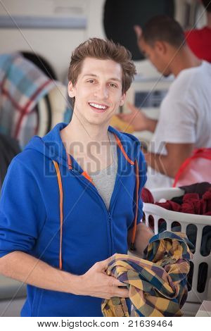 Smiling Man In Laundromat