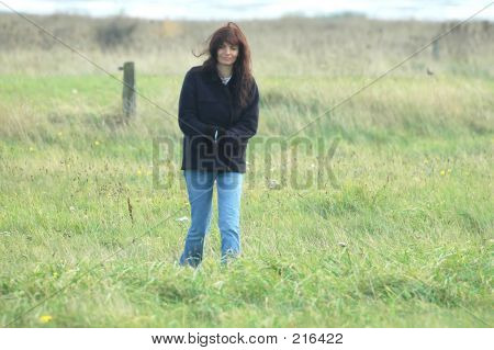 Woman In A Field