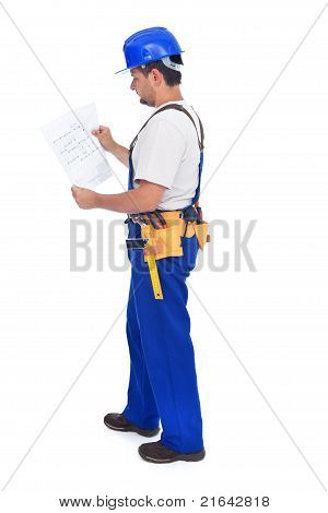 Handyman Or Construction Worker Checking The Blueprints