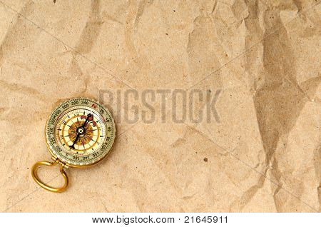Vintage compass on the paper