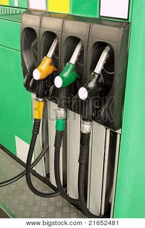 Green Gas Station With Nozzles