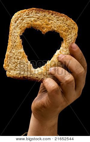 Slice Of Bread In Child's Dirty Hand