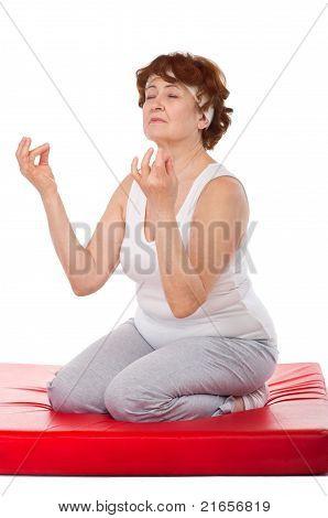 senior woman making yoga excercises
