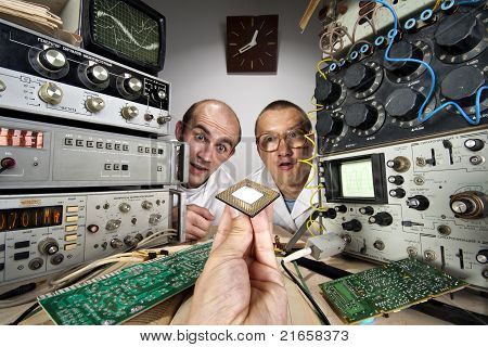 Two Funny Nerd Scientists Looking At Modern Computer Processor