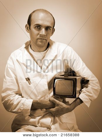 Pensive Scientist With Vintage Monitor