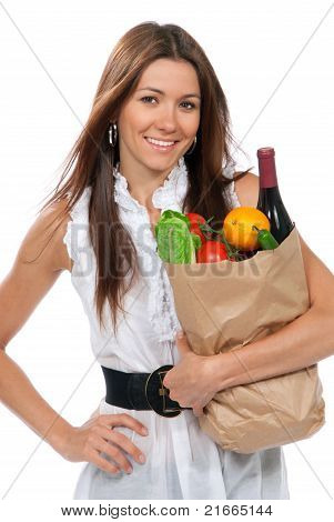 Happy Young Woman Holding A Paper Shopping Bag Full Of Groceries Salad