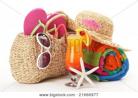 Beach bag with towel,flip flops, sunglasses and a glass of cocktail.Isolated on white background.