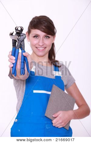 Cheerful woman in dungarees