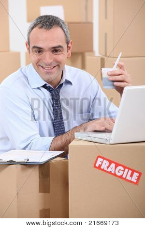 man amid cardboard boxes