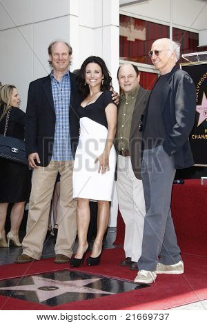 LOS ANGELES - MAY 4: Andy Ackerman, Julia Louis-Dreyfus, Jason Alexander, Larry David at a ceremony as Julia Louis-Dreyfus is honored with a star on the Walk of Fame in Los Angeles, CA on May 4, 2010