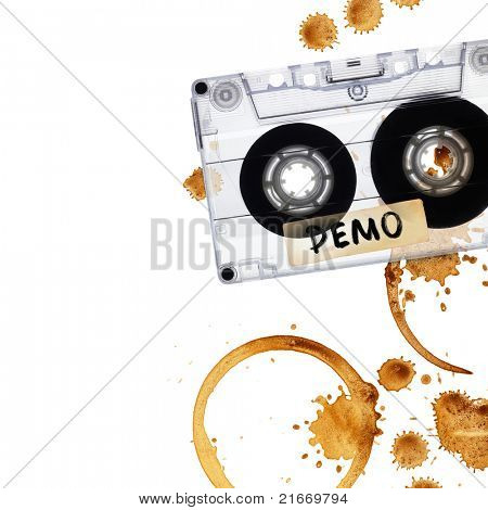Vintage demo tape with coffee stains. Isolated on white background