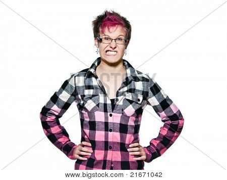 Portrait of an angry young expressive woman clenching teeth with hands on waist in studio on white isolated background