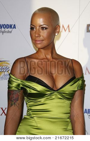 LOS ANGELES, CA - MAY 19: Amber Rose arrives at the 11th annual Maxim Hot 100 Party at Paramount Studios on May 19, 2010 in Los Angeles, California