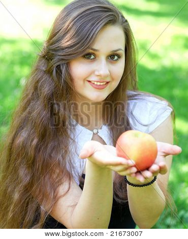 gorgeous young girl with sappy apple