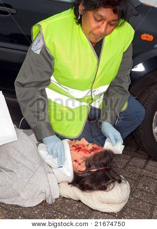 Female car crash victim with whiplash neck brace (the sleeve badges were replaced by a non existing logo)