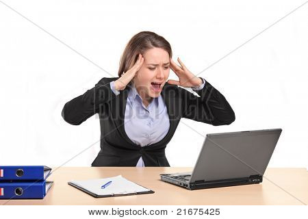 A nervous young businesswoman yelling isolated against white background