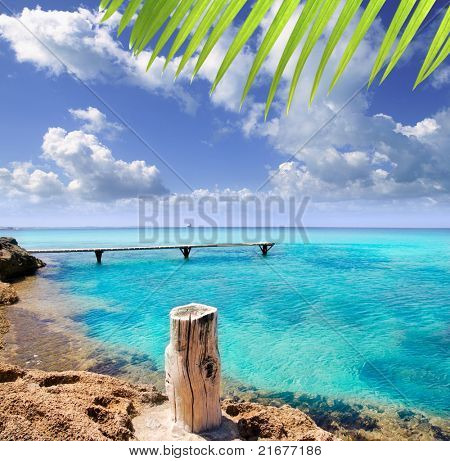 Illetes illetas beach with wooden pier and turquoise sea Formentera Balearic Mediterranean island