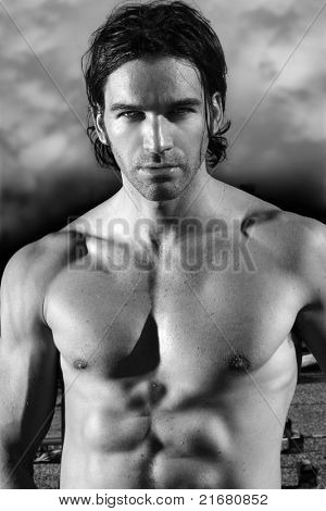 Fine art black and white portrait of a beautiful shirtless male model