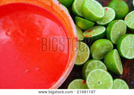 cut lemons after preparing achiote tikinchick Mayan traditional sauce in Mexico