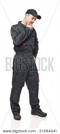 fine portrait of standing manual worker with garage suit