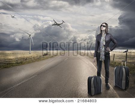 Young woman with baggage waiting for the airplane taxy