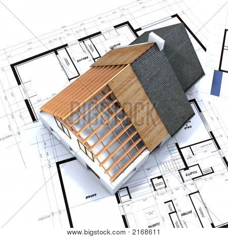 Aerial View Of House In Construction And Blueprints