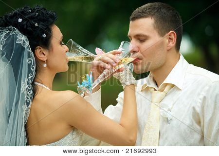 Bride and groom drinking champagne brotherhood