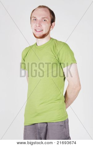 Portrait Of Man In Green Shirt Smiling