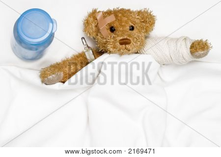 Teddy Bear As A Patient In Hospital'S Bed