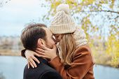 Loving Couple Walking In Park In Autumn Hugs And Kisses. Autumn Walk Men And Women In The Woods On T poster