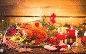 Christmas Dinner. Roasted chicken. Winter Holiday table served, decorated with candles. Roast turkey poster