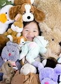 picture of mating bears  - A young girl is surrounded by her stuffed animals - JPG