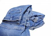 picture of partially clothed  - Stack of folded jeans with one pair partially unfolded - JPG