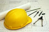 picture of structural engineering  - floor plans and a hard hat with various drawing tools  - JPG