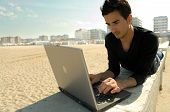 Man Working With Laptop Outdoor poster