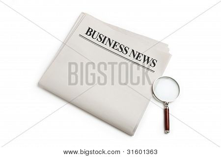 Business News And Magnifying Glass
