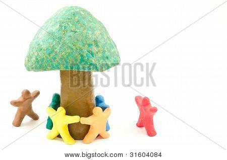 Dolls around a tree