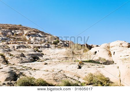 Caves On Mountain Slope In Bab As-siq