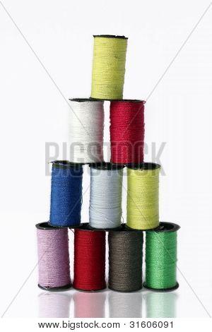 Ten Colored Spools Of Thread