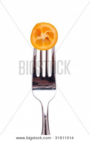 Orange Kumquat On Fork