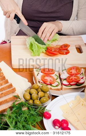 Woman Cutting Fresh Vegetable