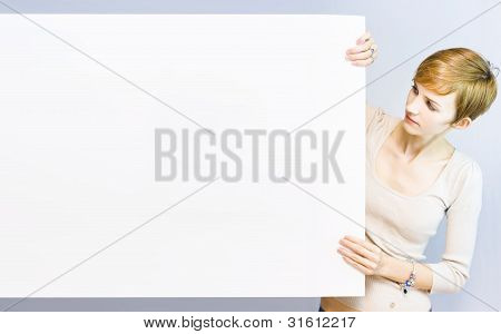 Pretty Woman Holding A Blank Sign