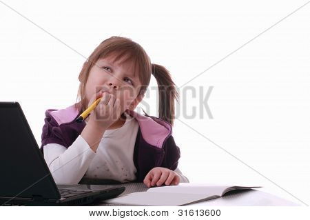 A Little Girl Is Sitting Near The Laptop And Thinks