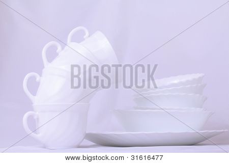 Set Of White Dishes On The Table