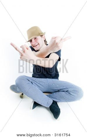 Emotional Teenager Sitting On Skate