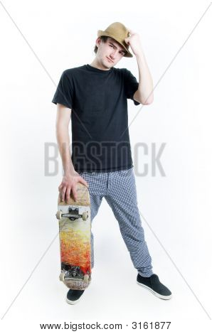 Serious Looking Teenager With Skate