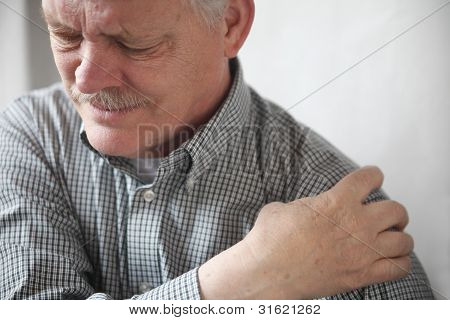 man with painful shoulder joint