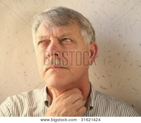 senior man with throat pain