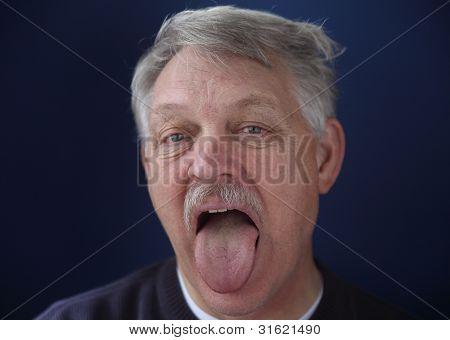 man showing his tongue